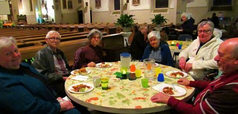 Photos from the Saturday Mass community potluck
